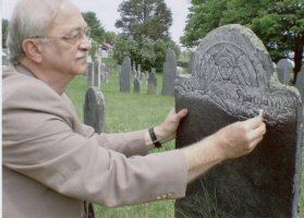 Rubbing chalk on a gravestone